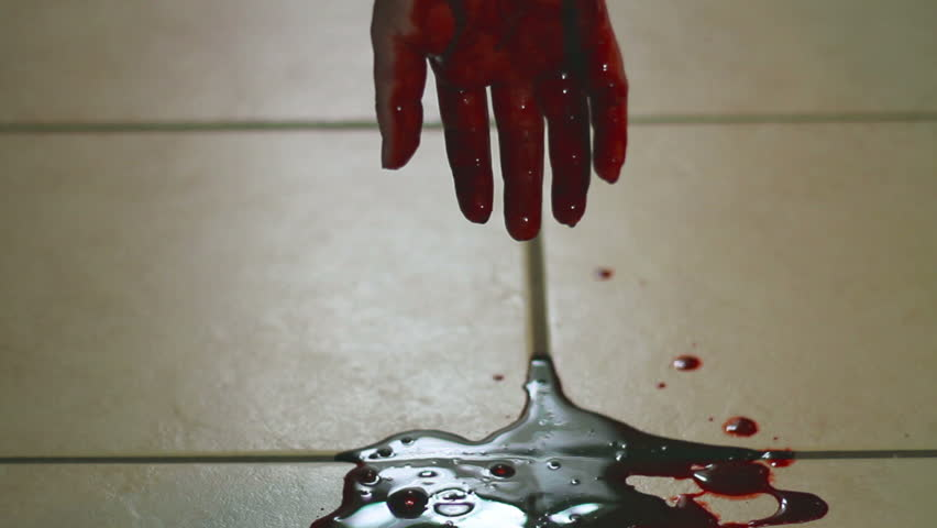 Hand Dripping Into Blood Pool On Tile Floor Stock Footage