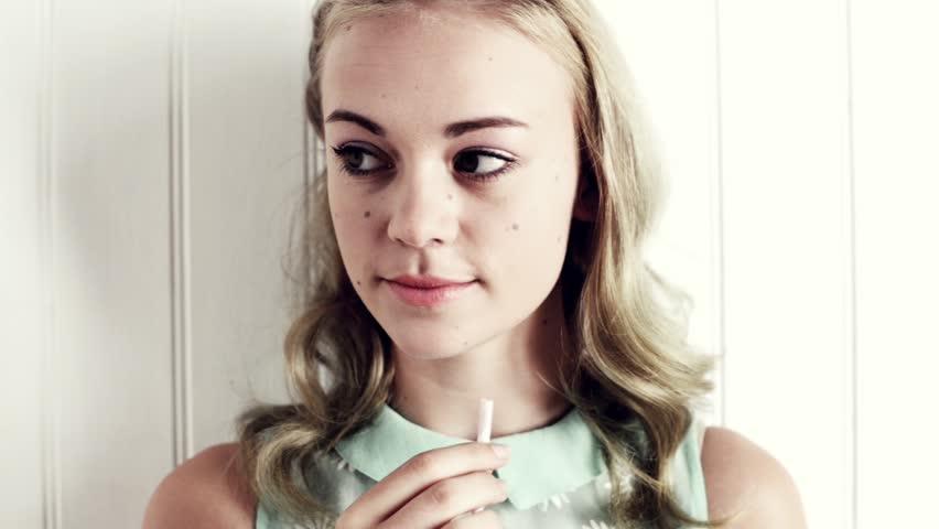 Pretty girl drinking milk with straw
