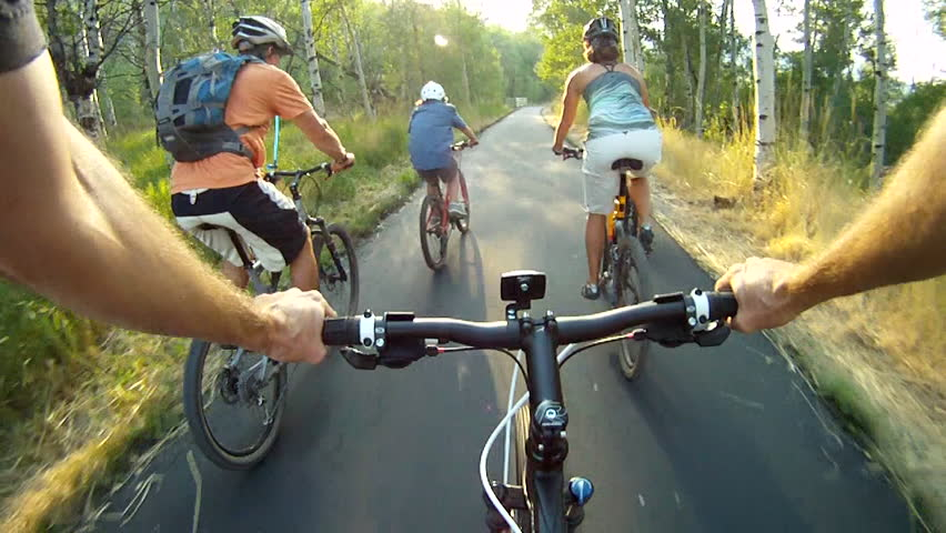 Family bike riding on forest trail POV | Shutterstock Video #4913756