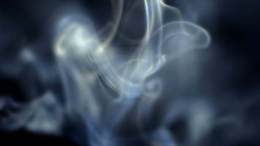 Smoke slowly floating through space against black background. 240 fps slow-motion.