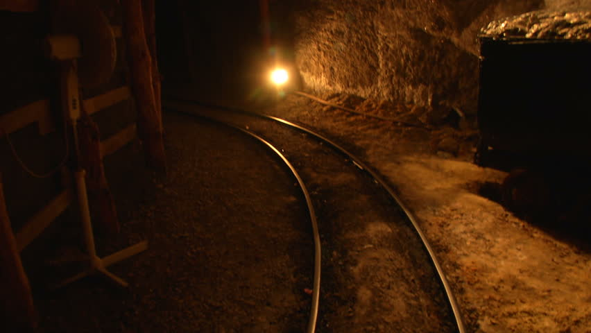 Mine tunnel with rails and light