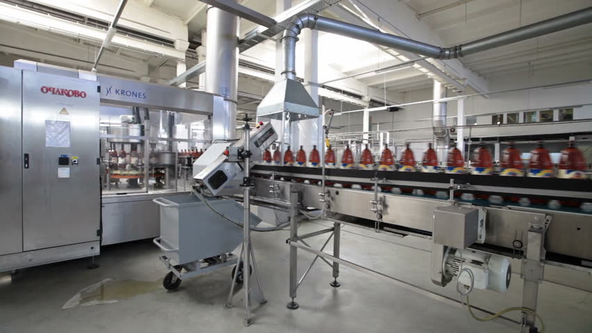MOSCOW, OCHAKOVO BREWERY - JUN 13: The biggest Russian company beer and beverage industry. Plastic beer bottles moving on conveyor on Jun 13, 2013 in Ochakovo brewery, Moscow, Russia. | Shutterstock HD Video #4945766