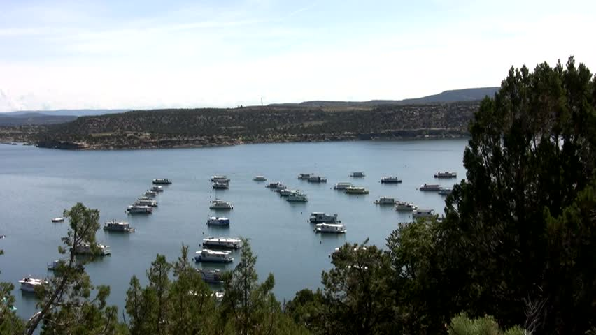 HD slow pan right to left across Navajo Lake and the marina on a summer morning in northern New Mexico