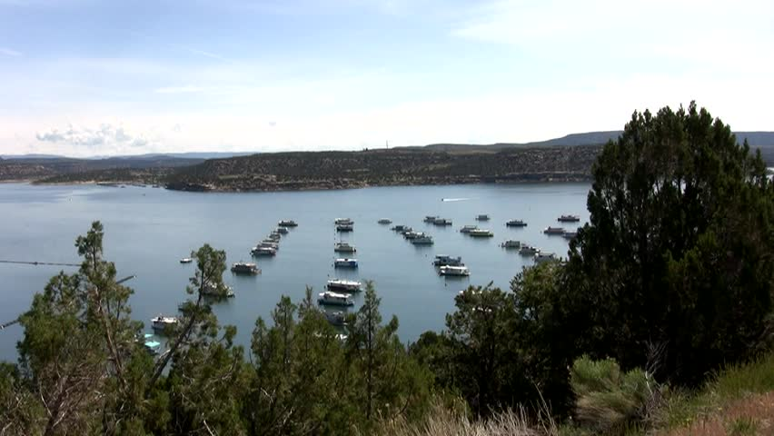 HD zoom in on a jet ski coming into the marina at Navajo Lake in northern New Mexico