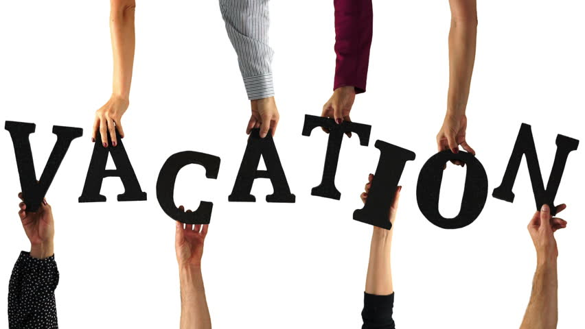Hands entering the screen and holding up the letters to spell the word VACATION.