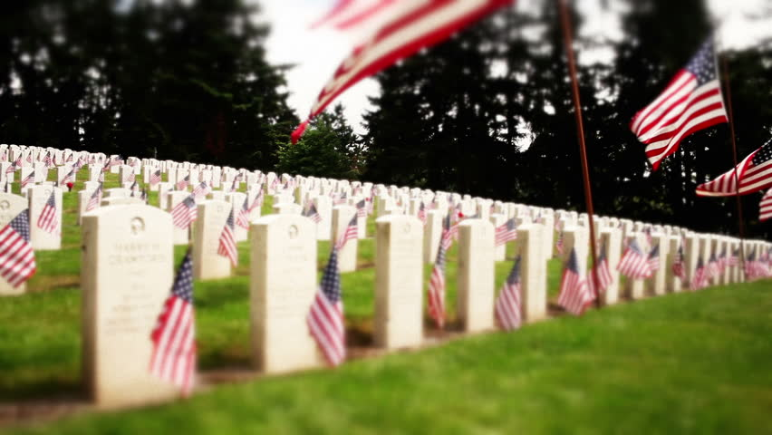 Tracking military cemetery, flowers and flags on tombstones