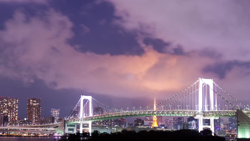 Tokyo bay with Rainbow Bridge and Tokyo Tower at night | Shutterstock HD Video #4995710