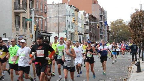 NEW YORK - NOV. 3, 2013:  Participants in the 2013 New York City Marathon on Lafayette Avenue in Brooklyn.