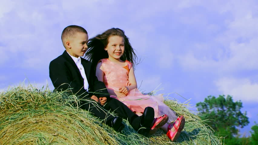 Stock video clip of two children in love on a haystack childhood stock video clip of two children in love on a haystack childhood shutterstock altavistaventures Choice Image