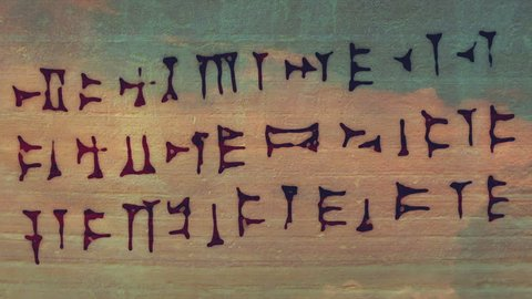 Cuneiform writing, ancient Sumerian. I just wrote random letters.