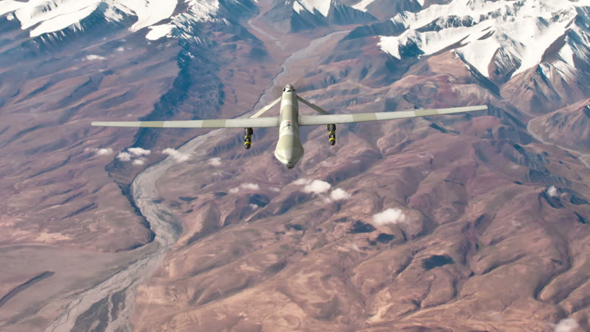 Military air drone fires missiles