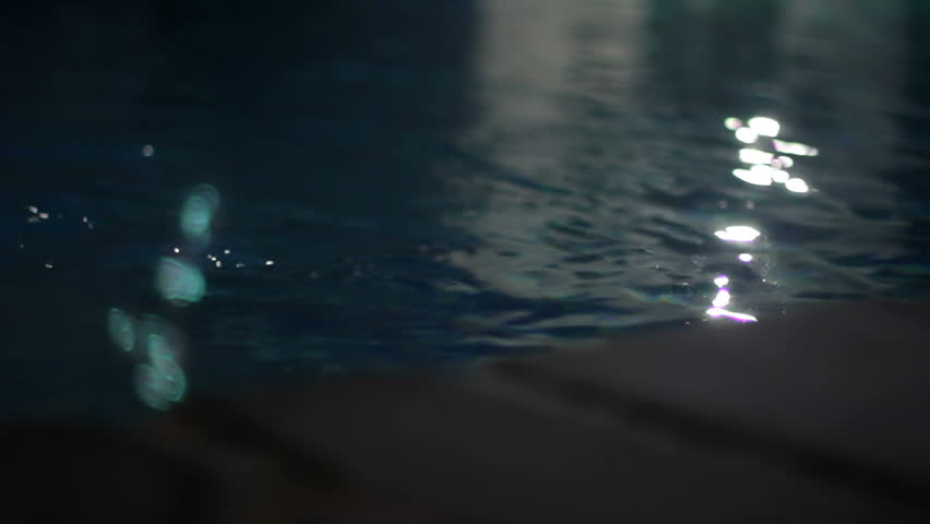 Stock Video Clip of Water running in a dark pool at Shutterstock