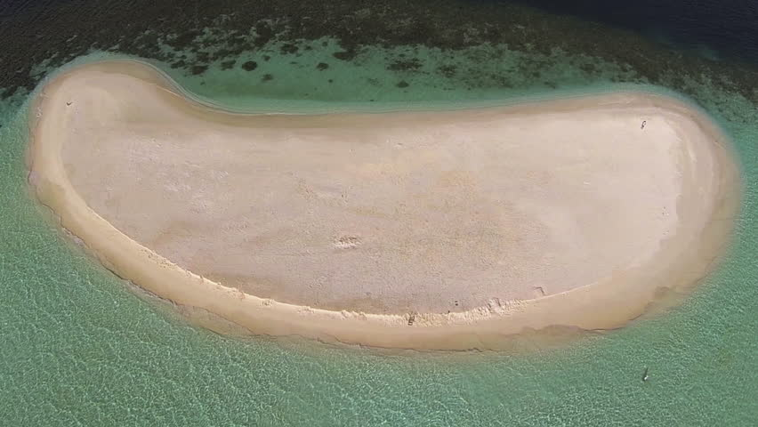 Maldives. Amazing beautiful sand island in the middle of the ocean. Slow fly by above the island.