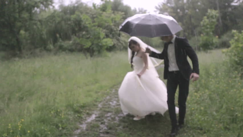 Wedding in the rain | Shutterstock HD Video #5055260