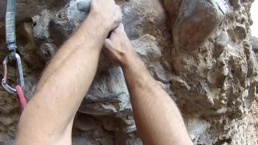 Rock Climber on Conglomerate POV. Climber on Sprout (13a) in Maple Canyon, UT.