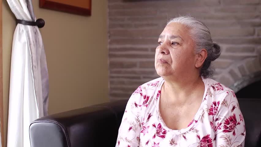 80 Year old elderly woman sits alone in a seniors residence. HD footage