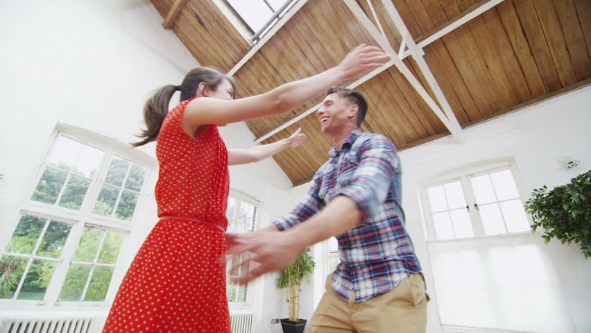 Happy young couple viewing a potential new home. In slow motion. | Shutterstock HD Video #5099249