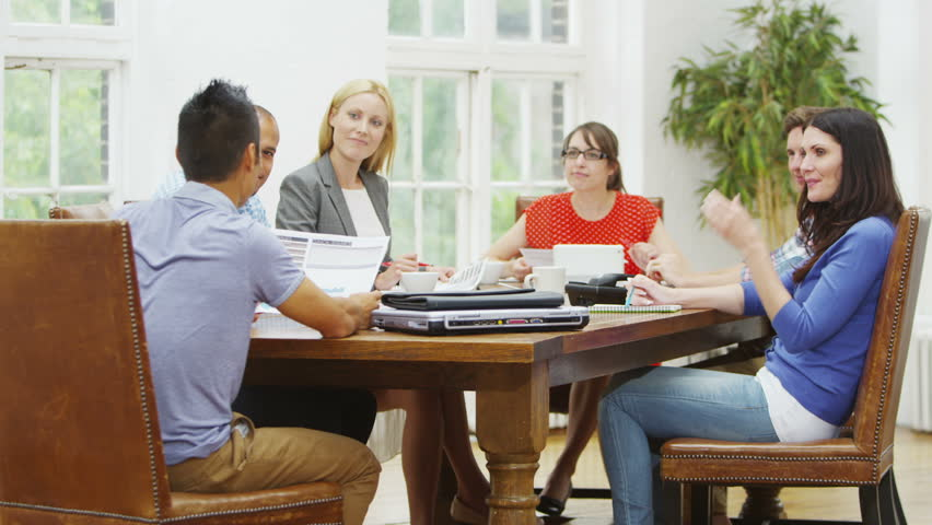 Casual Business People Talking At Desk Stock Image - Image ...  |Relaxed Business Person