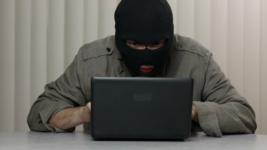 Hacker theft working with a laptop computer. Great video for and project