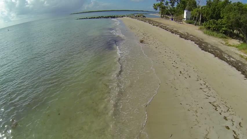 Empty beach low flyover