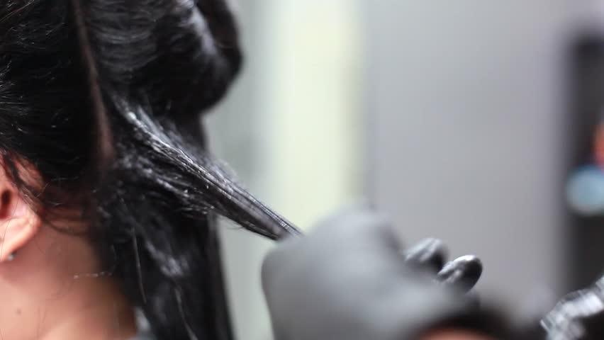 Professional Hairdresser Bleaching Girl's Hair