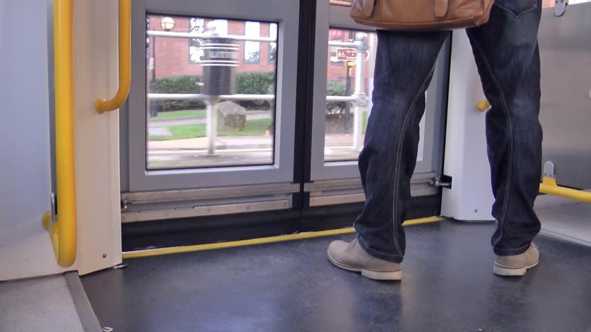 Manchester - Circa 2013: Passenger exits through tram doors on the Metro