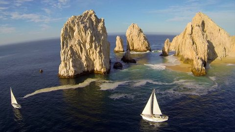 Beautiful aerial perspective of The Arch, El Arco, at Lands End with 2 Sailboats on the Sea of Cortez in Cabo San Lucas, Mexico