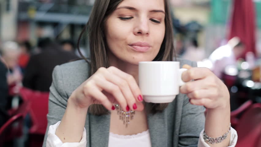 Pretty businesswoman drinking coffee and relaxing in cafe  | Shutterstock HD Video #5172938