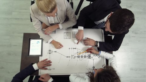 The above view of a professional team considering business solutions for their new project