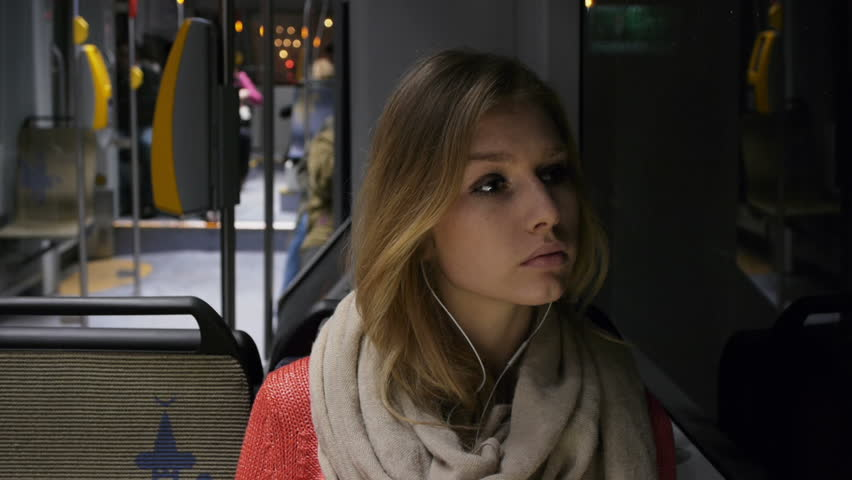 gorgeous pensive model on a tram
