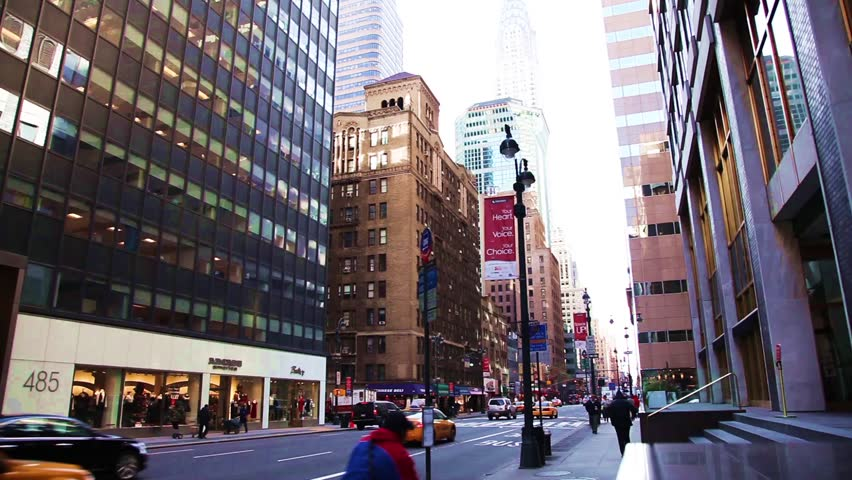 NEW YORK CITY - DEC 29: Famous Lexington Avenue with a view of the Chrysler building December 29th, 2009 in New York City. | Shutterstock HD Video #5186690