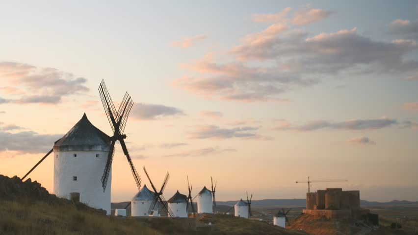 High definition time lapse video of the windmills and castle at Consuegra in Toledo province, Castilla La Mancha, Spain.