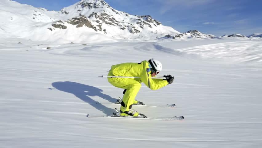 following alpine skier on ski piste to ski lift
