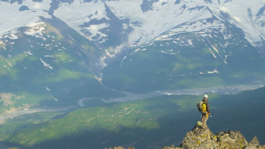 Aerial top of the world view of mountain climber in summer enjoying success high Peaks Troublesome Glacier Chugach Mountains, Alaska, USA shot on RED EPIC, 4K, UHD, Ultra HD resolution
