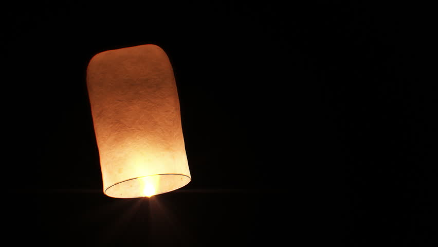 Beautiful Single Paper Lantern flying Slow. Isolated on Black background. No people. 3d animation. HD 1080.