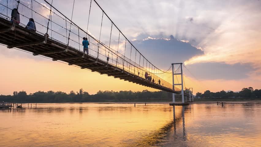 Time lapse sunset Suspension Bridge at Tak Province, Thailand landmark.