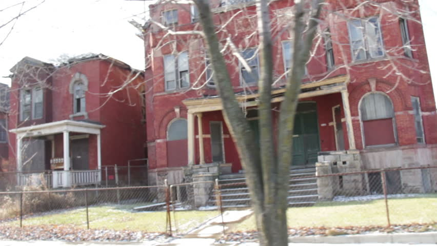 Detroit Ghetto Driving 4. Driving through another economically depressed neighborhood of Detroit, Michigan. Dangerous neighborhood, and very run down. POV.  | Shutterstock HD Video #5208800