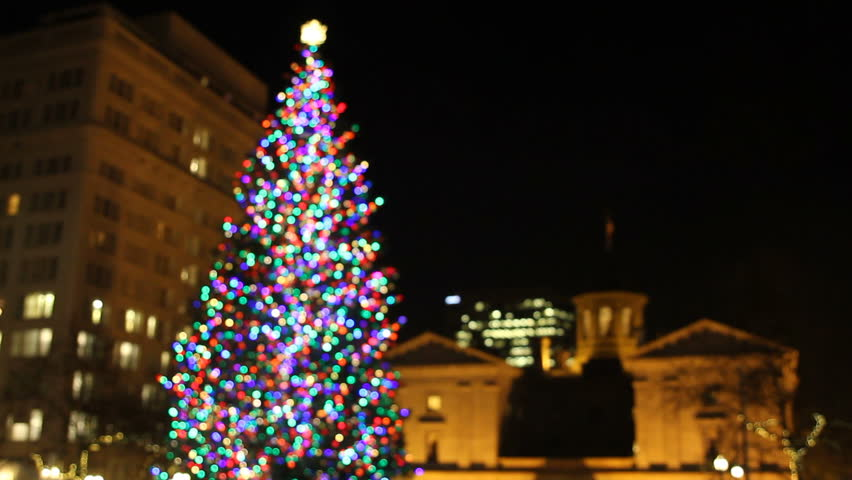 Holiday Christmas Tree with Festive Colorful Lights in Pioneer Courthouse Square with Historic Buildings at Night 1920x1080