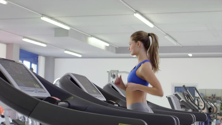 People training in fitness club, gym and sport activity. Young man and woman working out and running on treadmill, athletes with wellness equipment. 2of27