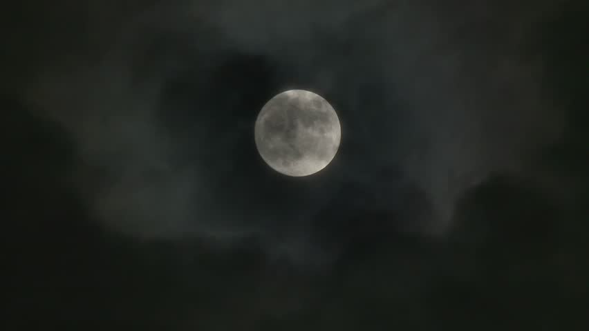 A realtime shot of the full moon on a cloudy night. Not computer generated. In 4K UltraHD.