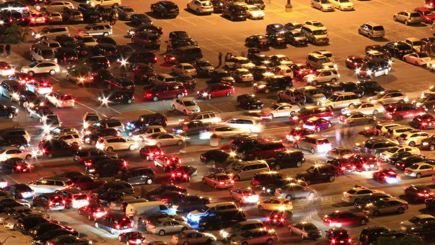 Parking Lot Night Timelapse. Time-lapse night shot of a crowded parking lot emptying out after a large event. Pans and tilts. | Shutterstock HD Video #5237780