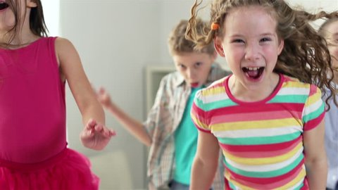 Close-up of children having pure fun jumping around, slow-motion