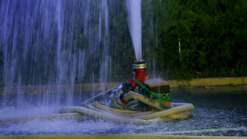 Pan Shot Of Two Hydrants One Of Which Is Spurting The Water In The ...