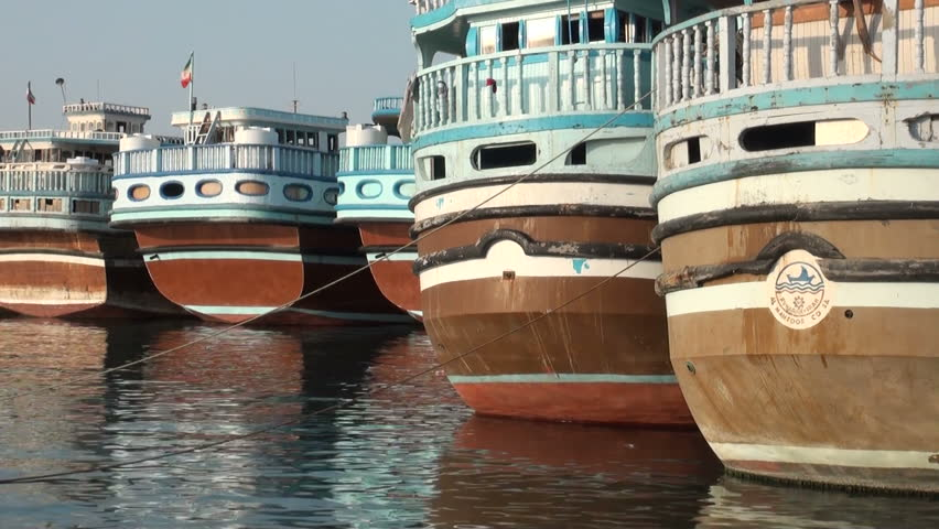 BANDAR ABBAS, IRAN - 31 OCTOBER 2013: Colorful sterns of traditional 'lenj' fishing boats, that are still used in the Persian Gulf, in the harbor of Bandar Abbas, Iran