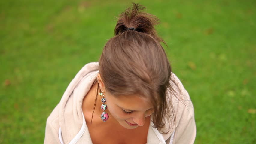 Pretty student sitting on grass using laptop on college campus | Shutterstock HD Video #5276120