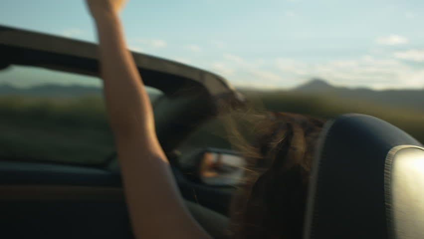 Teen Girls In A Convertible On A Road Trip, Dancing, Raising Hand, Talking
