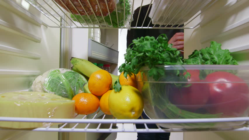 Female hand takes out meat and vegetables from the fridge, inside view | Shutterstock HD Video #5303486