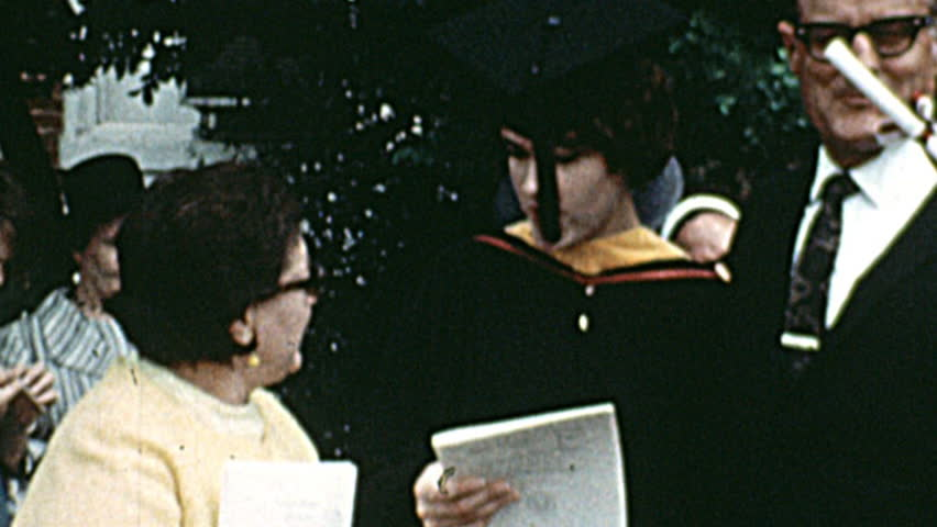 USA – 1968: family at the graduation ceremony of the daughter on 1968 in USA.