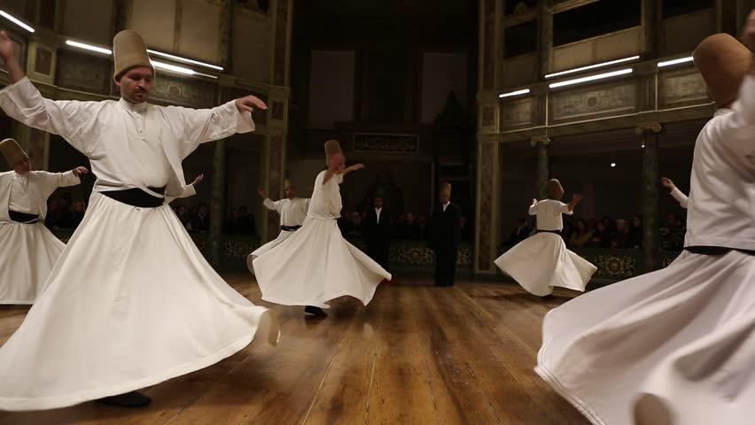 ISTANBUL, TURKEY - DECEMBER 17: Sufi whirling dervish (Semazen) dances on December 17, 2013 in Istanbul, Turkey.