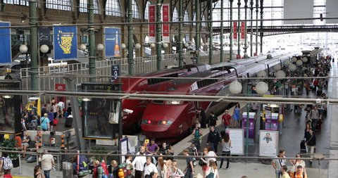 PARIS, FRANCE - JULY 26, 2013 Gare du Nord Paris, North Station Eurostar Thalys TGV High Speed Trains and French People Commuters Daytime ( Ultra High Definition, Ultra HD, UHD, 4K, 2160P, 4096x2160 )
